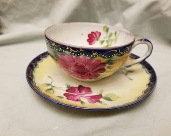 Very nice hand painted Tea cup and saucer large pink flowers and cobalt blue trim