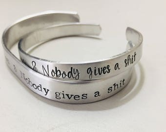 "Custom ""Nobody knows you & Nobody gives a sh*t"" Cuff bracelets"