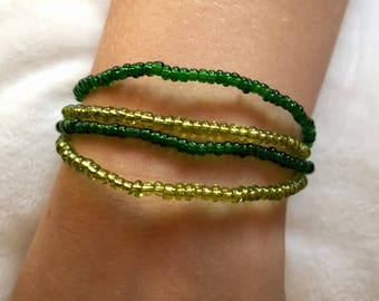 4 green glass beaded bracelets