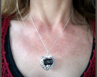 Filigree heart pendant in 925 sterling silver with a tourmaline biterminee (gemstone).