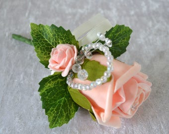 Wedding. Event. 2 peach corsages.