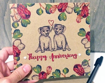 Happy Anniversary Card with Puppies and Tropical Border, unique illustrated greeting card for wife, girlfriend. Square brown kraft recycled