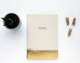 Nude and gold notebook