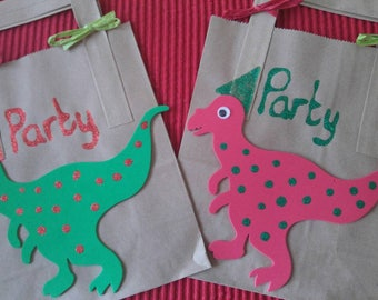 Dinosaur Party Pags in packs of 10. Each set has 5 red and 5 green. Girl's or boy's party. Add favors, gifts and cake. Alternative bags.