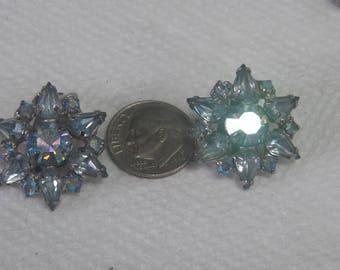 Weiss Clip on Star like Light blue Earrings