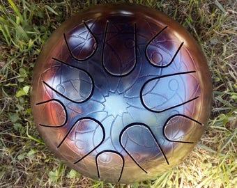 tank drum, steel tongue drum, slit drum, hank drum, handpan