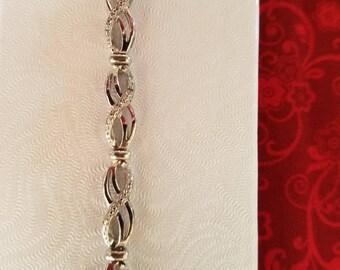 BR105 Infinity Bracelet with Genuine Diamonds