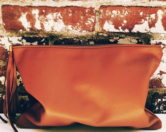 NK- Rust color Leather Zipper Clutch. Large Leather  Makeup Pouch. Leather Bag with long tassel. Large leather pouch