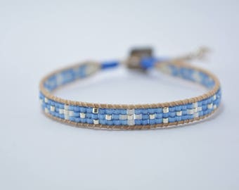 Bracelet glass beads Miyuki blue and mother of Pearl, beige leather and silver beads