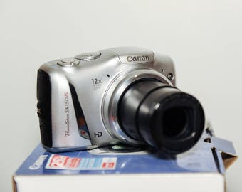 Canon PowerShot SX150 IS Compact digital camera with orginal box and paperwork 14.1 mp pp #374