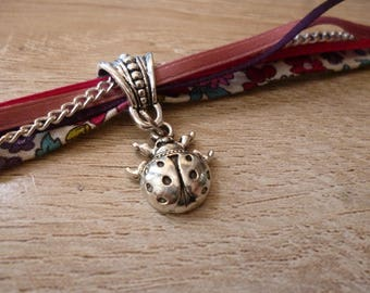 Several ribbons with Ladybird charm bracelet