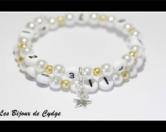 Nursing bracelet on memory wire form of 55mm with glass beads white and light gold