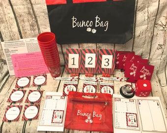 12 Person Bunco Game Starter Kit: Pink & Purple Zebra. Score cards, Table Numbers, dice, Us vs Them Tally Sheets, Bunco Basics, Bunco Bag