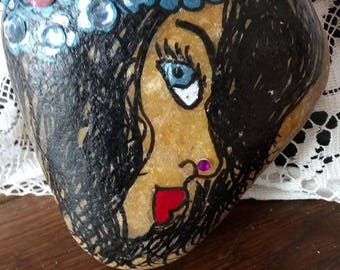 large stone with Rhinestones and varnished has nails