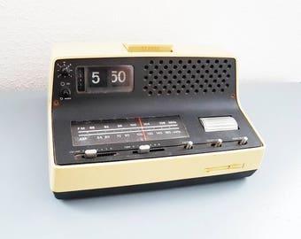 Vintage '70s flip alarm clock radio in used condition
