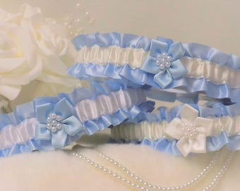 Wedding garter/Bridal garter. Blue satin with White or Ivory. Poinsettia flower and pearls.