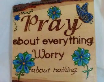 Wood burned sign Pray About Anything painted and embellished with colored crystals