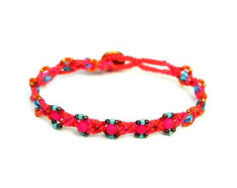 Peer's hand knotted bracelet: neon pink, poinsetta and Venetian red c lon bead cord, diverse glass beads and a button clasp