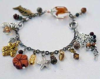 Hawaiian Charm Bracelet, Flower Charm Bracelet, Black and Silver Dangles, Mixed Metal Bracelet, Wooden Charm Bracelet, Fish Skeleton Charm