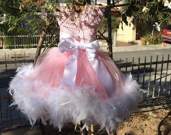 Beautiful handmade children dress. Decorated with satin ribbon and feathers.