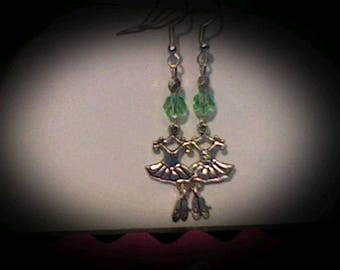 Ballerina earrings sliver charms w/green bead accents.