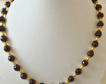 Garnet necklace faceted 10 mm and Golden beads