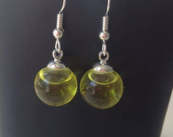 Ball earring, glass and colored liquid