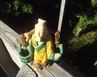 Glazed Pottery Mud Man Chinese Asian Water Carrier 3 1/2 inches Tall. Nice Colors