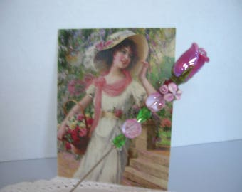 A Vintage hatpin with a mauve rose