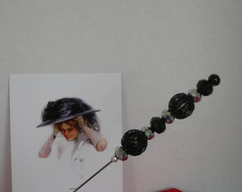 An Antique hatpin dressed in black