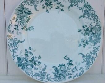 Vintage French terre de fer serving plate. Green and white floral design.