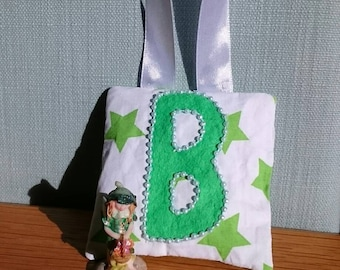 GREEN star tooth fairy pouch door-hanger with GREEN letter, GREEN beaded border, and green diagonal pocket on reverse for tooth/coin.