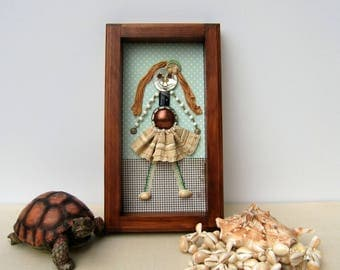 Small unique figurines made of antiques. Wall frame, girl's room.