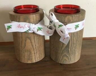A pair of oak tea light holders