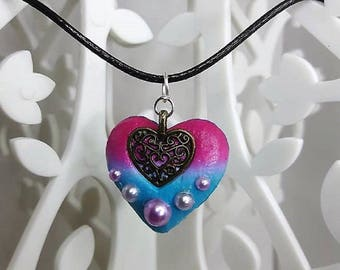 Small heart necklace made of polymer clay with a metal heart