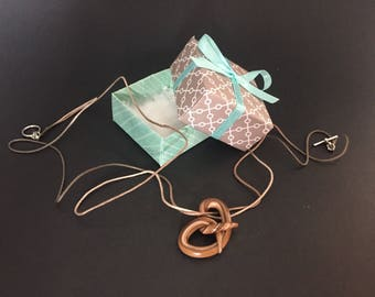 Polymer clay pretzel charm necklace in a gift box