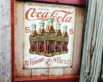 Vintage Tin Coca Cola Sign on Reclaimed Wood