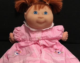 Cabbage Patch kid doll (this doll could be immitation but still very cute! ) see photos