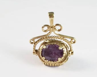 Vintage triple amethyst fob in yellow gold