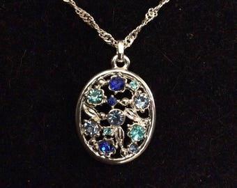 Openwork Floral Silvertone Pendant with Blue Rhinestones