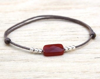 Faceted red agate gem stone cord bracelet