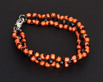 Orange and Black Double Stranded Beaded Bracelet with Lobster Clasp