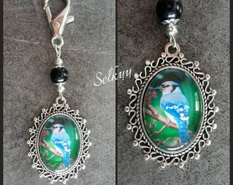 Keychain image of a bird (chickadee type) tone blue/green oval cabochon glass and silver s