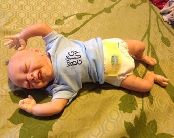 Premie baby boy or girl in blue
