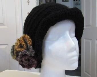 Black beanie cap with a soft flower