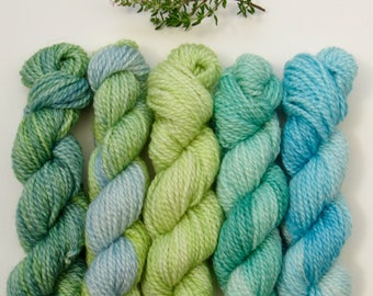 Set of five 10g mini skeins on merino and bamboo blend 4ply knitting wool yarn in greens and blues