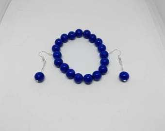 Dark blue plastic beaded bracelet and silver plated drop earring jewellery set