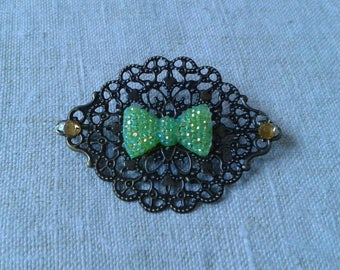 print and yellow rhinestone bow brooch