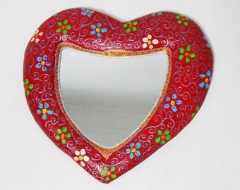 "mirror""stitched""on volume carved heart"