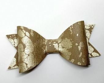 Gold splash skinny bow